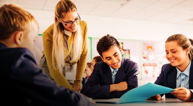 Teacher helping students in class