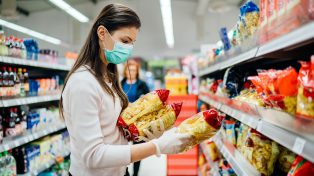 Woman looking at pasta in a supermarket