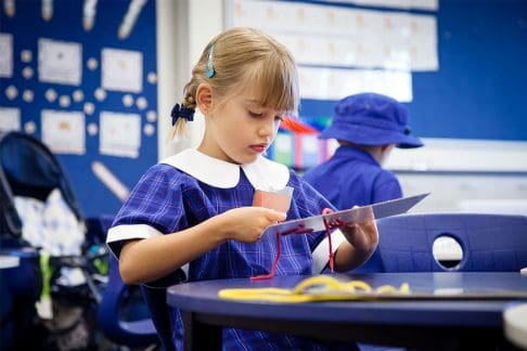 Girl at primary school doing craft