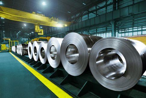 Rolls of steel in a warehouse