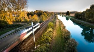 Bullet train speeding across landscape in France