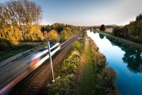 Bullet train speeding across landscape in France