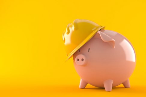 Piggy bank in a hard hat