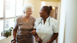 Older woman with a nurse in an aged care setting