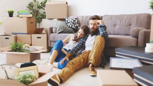 A young couple looking stressed among moving boxes