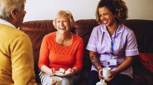 Aged care worker talking to senior people