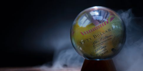 Mysterious crystal ball with a $50 note inside