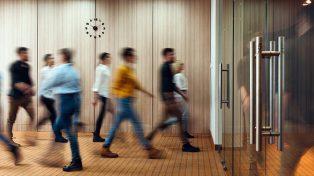 People walking into office